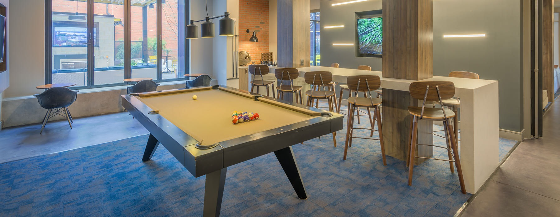 billiards table in brightly lit clubhouse