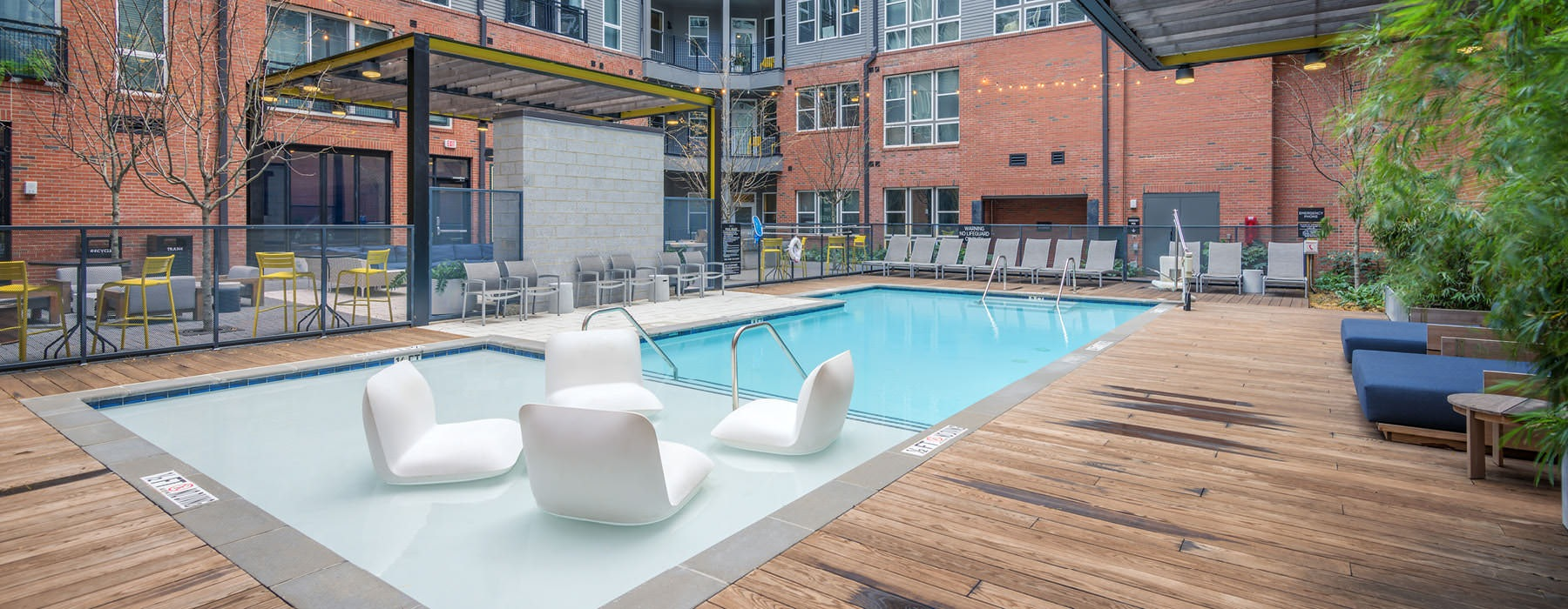outdoor swimming pool with in-pool lounge chairs